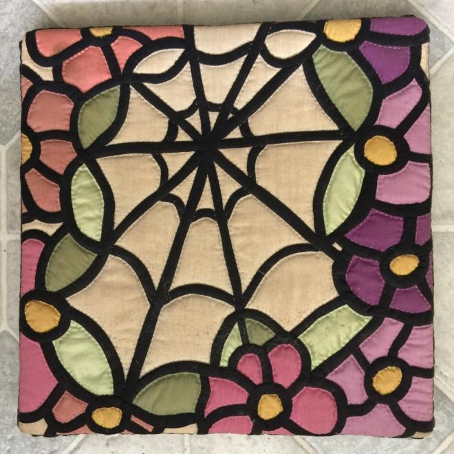 spider's web seat cover by Sally Eklund