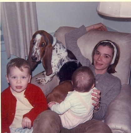 Sally Eklund with her two oldest children and family basset hound, circa 1968