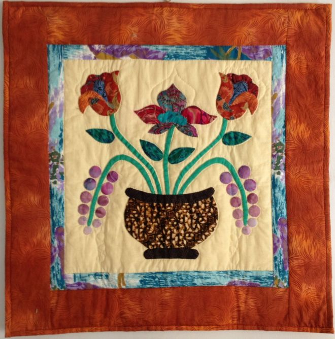 vase of flowers, a quilt by Sally Eklund