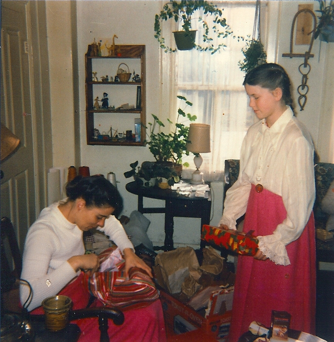 opening gifts with daughter in the 1970s