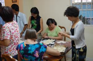 Sally and members of the Taiwanese community on St. Vincent plus her daughter-in-law prepare for a Lunar New Year feast in 2008