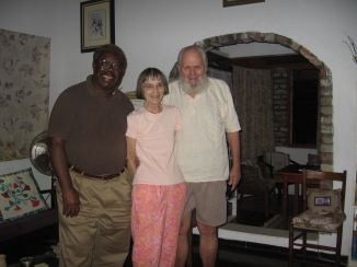 with husband and friend Baldwin in 2013