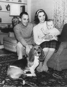 with husband, first child, and family Basset Hound in 1965