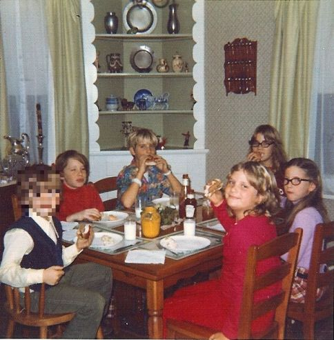 Sally's three children eating lunch at grandma's house with her younger sister's children in the mid 1970s